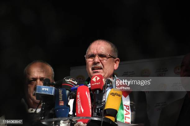 Noureddine Taboubi the general secretary of the UGTT labor union gives a speech from the balcony of the UGTT headquarters during a gathering of...