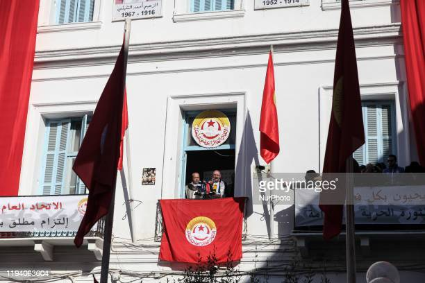 Noureddine Taboubi the general secretary of the UGTT labor union gestures as he gives a speech from the balcony of the UGTT headquarters during a...