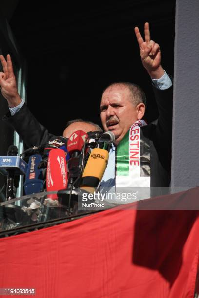 Noureddine Taboubi the general secretary of the UGTT labor union makes the victory sign as he gives a speech from the balcony of the UGTT...