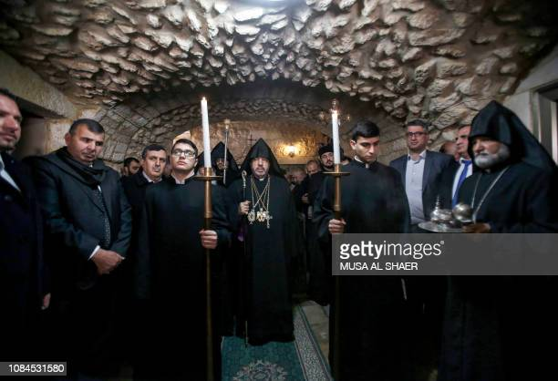 TOPSHOT Nourhan Manougian the Armenian Patriarch of Jerusalem leads mass at the Church of the Nativity in the Biblical West Bank city of Bethlehem on...
