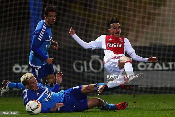 Nouri Abdelhak of Ajax is challenged by Artjoms Rudnevs and Nicolai Mueller of Hamburg during a friendly match between Hamburger SV and Ajax...