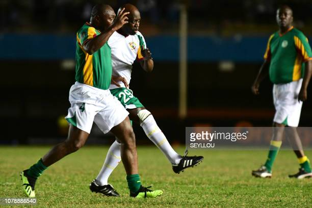 Nouridine Naybet from the Legends of the Caf vies for the ball with Pape Fall during the match of the Legends in homage of Jules Francois Bocande on...