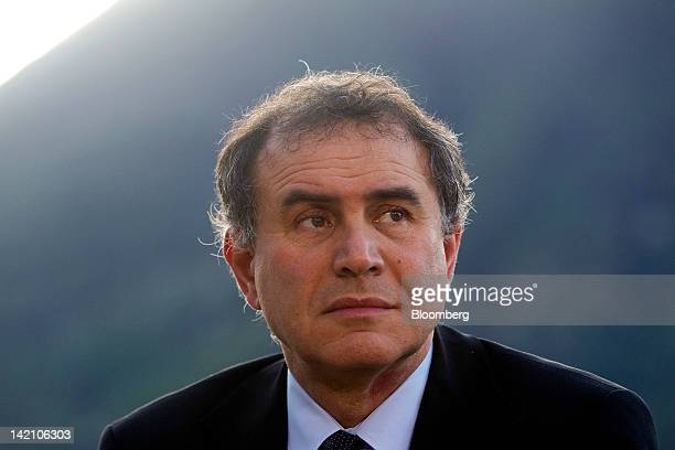 Nouriel Roubini, co-founder and chairman of Roubini Global Economics LLC, pauses during a television interview at the Ambrosetti Workshop in...