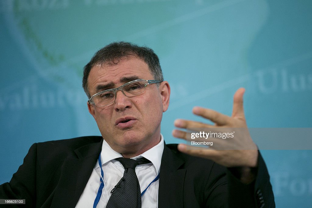Nouriel Roubini, co-founder and chairman of Roubini Global Economics LLC, speaks at a macro policy discussion during the International Monetary Fund (IMF) and World Bank Group Spring Meetings in Washington, D.C., U.S., on Wednesday, April 17, 2013. As much as 20 percent of non-bank corporate debt in the weakest euro-area economies is unsustainable and may force companies to cut dividends and sell assets, dealing further blows to investor confidence, the IMF said. Photographer: Andrew Harrer/Bloomberg via Getty Images