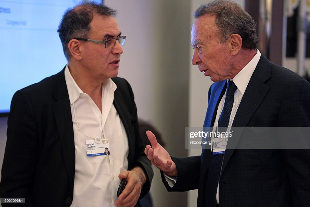 Nouriel Roubini, economist and chairman of Roubini Global Economics, LLC., left, speaks with Guillermo Ortiz, chairman of Banco Mercantil del Norte S.A., between sessions during the World Economic Forum (WEF) in Davos, Switzerland, on Thursday, Jan. 21, 2016. World leaders, influential executives, bankers and policy makers attend the 46th annual meeting of the World Economic Forum in Davos from Jan. 20 - 23. Photographer: Jason Alden/Bloomberg via Getty Images