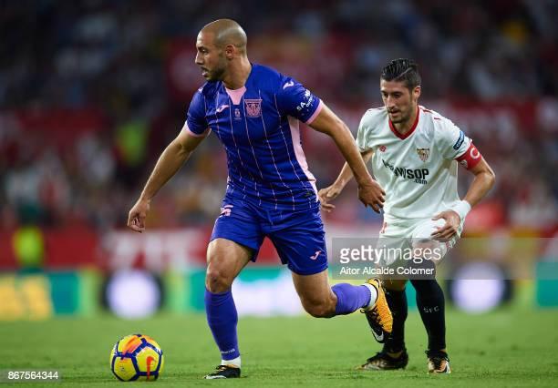 Nourredine Amrabat of CD Leganes being followed by Sergio Escudero of Sevilla FC during the La Liga match between Sevilla and Leganes at Estadio...