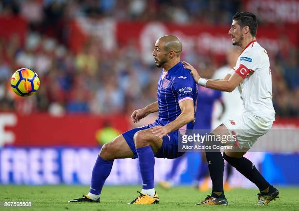 Nourredine Amrabat of CD Leganes competes for the ball with Sergio Escudero of Sevilla FC during the La Liga match between Sevilla and Leganes at...