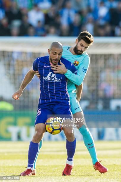 Nourredine Amrabat of CD Leganes fights for the ball with Gerard Pique Bernabeu of FC Barcelona during the La Liga 201718 match between CD Leganes vs...