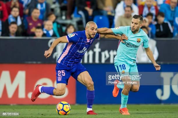 Nourredine Amrabat of CD Leganes fights for the ball with Jordi Alba Ramos of FC Barcelona during the La Liga 201718 match between CD Leganes vs FC...