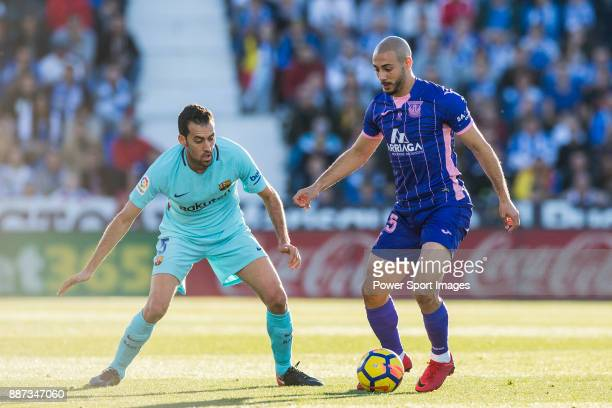 Nourredine Amrabat of CD Leganes fights for the ball with Sergio Busquets Burgos of FC Barcelona during the La Liga 201718 match between CD Leganes...