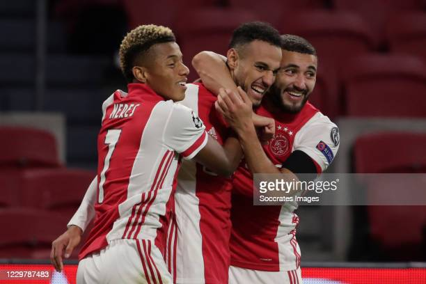 Noussair Mazraoui of Ajax Celebrates 2-0 with David Neres of Ajax, Zakaria Labyad of Ajax during the UEFA Champions League match between Ajax v FC...
