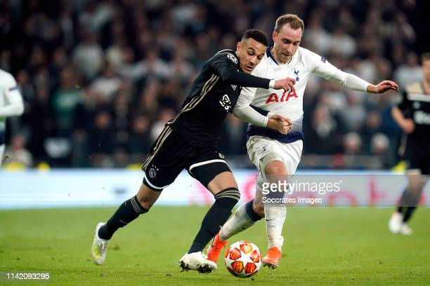 Noussair Mazraoui of Ajax Christian Eriksen of Tottenham Hotspur during the UEFA Champions League match between Tottenham Hotspur v Ajax at the...