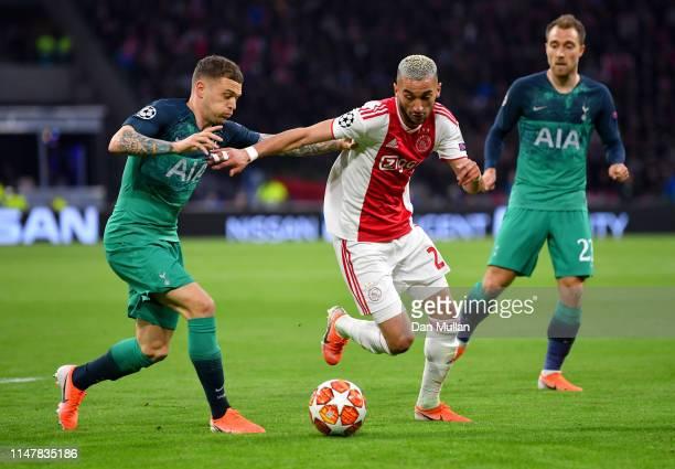Noussair Mazraoui of Ajax is challenged by Kieran Trippier of Tottenham Hotspur during the UEFA Champions League Semi Final second leg match between...