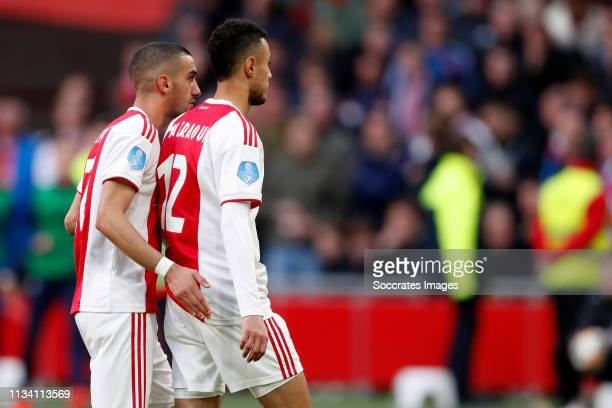 Noussair Mazraoui of Ajax leaves the pitch after a red card Hakim Ziyech of Ajax during the Dutch Eredivisie match between Ajax v PSV at the Johan...