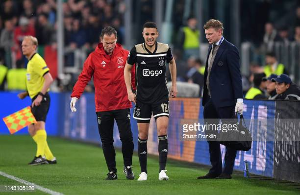 Noussair Mazraoui of Ajax receives medical treatment during the UEFA Champions League Quarter Final second leg match between Juventus and Ajax at...