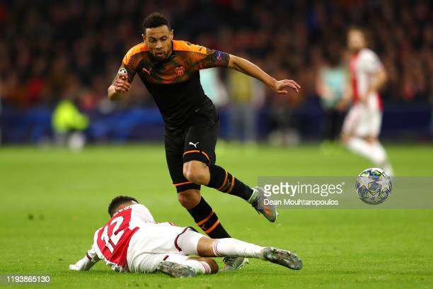 Noussair Mazraoui of Ajax tackles Francis Coquelin of Valencia during the UEFA Champions League group H match between AFC Ajax and Valencia CF at...