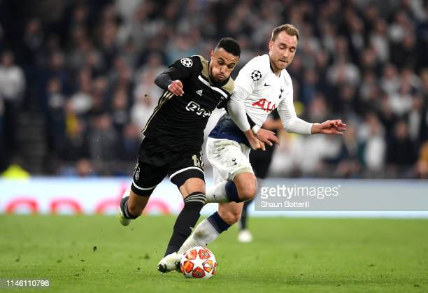 Noussair Mazraoui of Ajax takes on Christian Eriksen of Tottenham Hotspur during the UEFA Champions League Semi Final first leg match between...