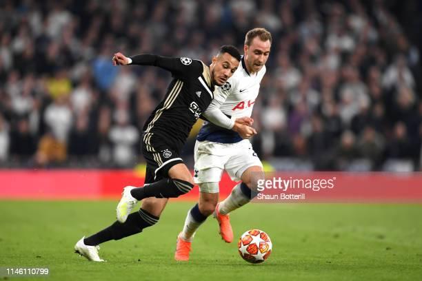 Noussair Mazraoui of Ajax takes on Christian Eriksen of Tottenham Hotspur during the UEFA Champions League Semi Final first leg match between...
