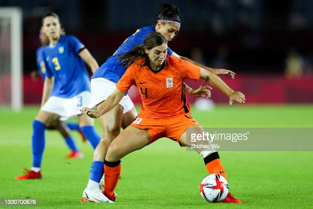 Nouwen Aniek of Netherlands competes for the ball with Beatriz of Brazil during the Women's First Round Group F match on day one of the Tokyo 2020...