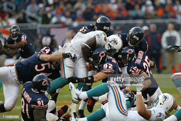 Nov 05 2006 Chicago IL USA The Miami Dolphins RONNIE BROWN against the Chicago Bears HUNTER HILLENMEYER at Soldier Stadium The Dolphins defeated the...