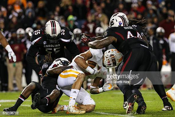 Tennessee Volunteers running back Jalen Hurd is stopped at the line by South Carolina Gamecocks cornerback Chris Lammons South defensive end Gerald...