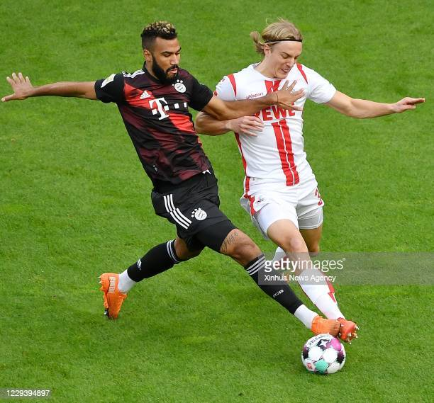 COLOGNE Nov 1 2020 Eric Maxim ChoupoMoting L of Munich vies with Sebastiaan Bornauw of Cologne during a German Bundesliga football match between FC...