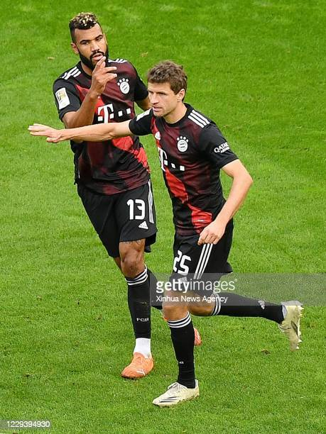 COLOGNE Nov 1 2020 Thomas Mueller R of Munich celebrates scoring with his teammate Eric Maxim ChoupoMoting during a German Bundesliga football match...