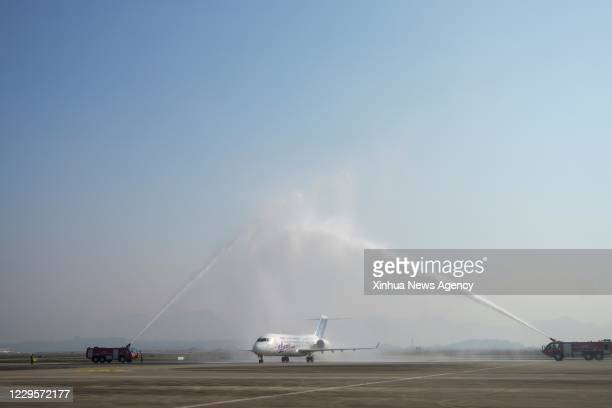Nov. 10, 2020 -- An ARJ21 jetliner passes a water gate at the Chongqing Jiangbei International Airport in Chongqing, southwest China, Nov. 10, 2020....