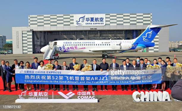 Nov. 10, 2020 -- Guests pose for photos with a newly-delivered ARJ21 jetliner at the Chongqing Jiangbei International Airport in Chongqing, southwest...