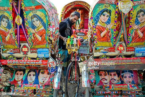Nov 12 2015 Dhaka Bangladesh Rickshaw Puller is parking his rickshaw after work