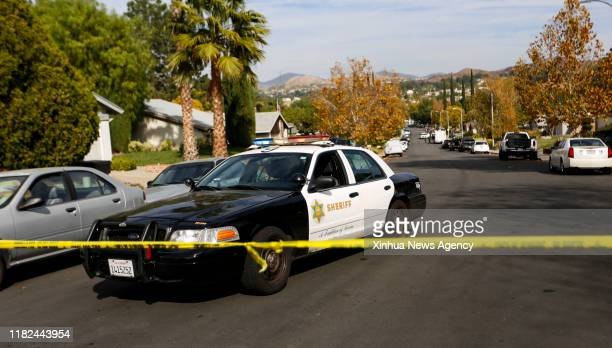 Nov. 14, 2019 -- A sheriff car is seen near the suspect's home in Santa Clarita, Southern California, the United States, on Nov. 14, 2019. At least...