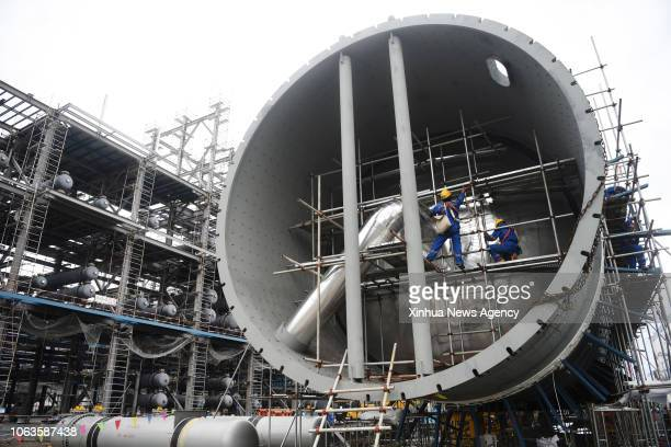 BEGAWAN Nov 17 2018 Builders work at the construction site of the cooperation project between China's Zhejiang Hengyi Group Co Ltd and the Brunei...