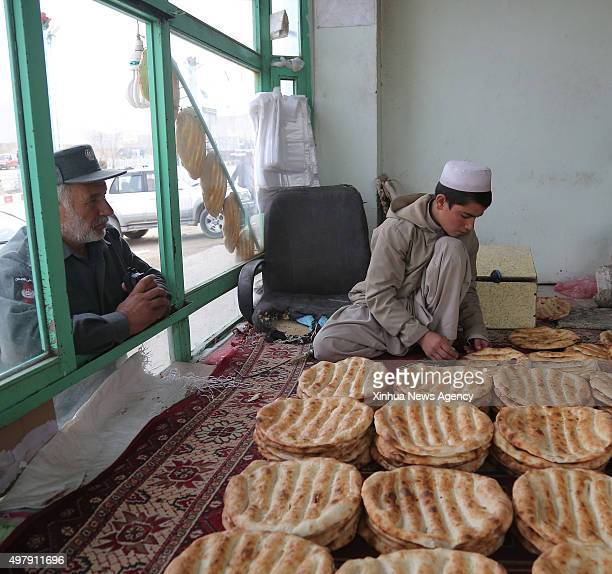 KABUL Nov 19 2015 An Afghan man prepares bread for sell at a bakery in Wardak province Afghanistan Nov 19 2015