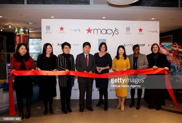NEW YORK Nov 19 2018 Guests cut the ribbon during the opening ceremony of the Shanghai Food Festival and Tourism Promotion at Macy's flagship store...