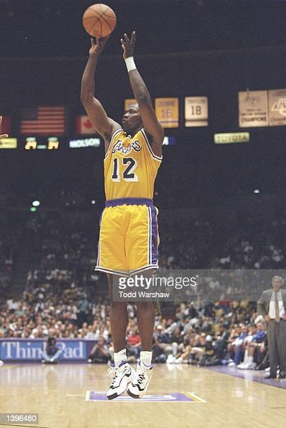 Forward Jerome Kersey of the Los Angeles Lakers shoots the ball during a game against the Utah Jazz at the Great Western Forum in Inglewood...