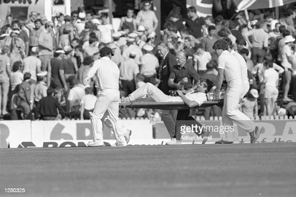 Terry Alderman is stretchered off the pitch with a dislocated shoulder after being attacked by a spectator during the 1st Test between Australia and...