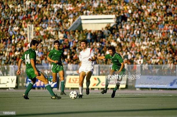 Nizar Mahrous of Syria takes on the Iraq defence during the World Cup qualifying match against Iraq played in Damascus Syria The match ended in a 00...