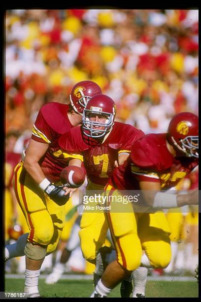 Quarterback Sean Salisbury of the USC Trojans hands off the ball during a game against the Washington State Cougars at the Los Angeles Memorial...