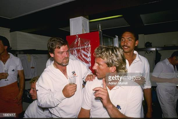 Mike Gatting Ian Botham and Phil DeFreitas of England relaxing after England's 1st test win over Australia at Brisbane Australia Mandatory credit...