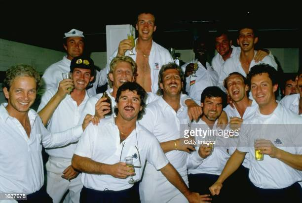 The England team celebrate after winning the First Ashes Test match against Australia at Woolloongabba in Brisbane Australia England won the match by...