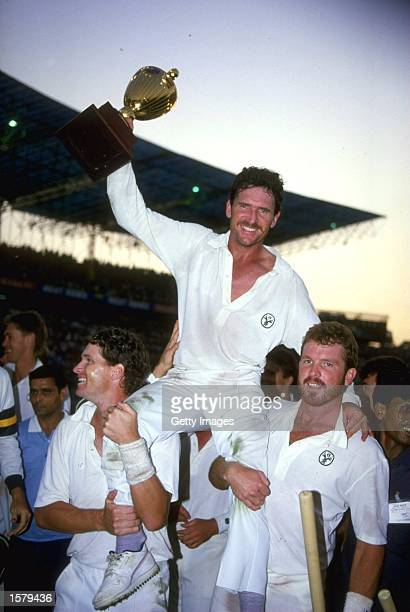 Allan Border of Australia lifts the World Cup after Australia beat England in the final in Calcutta He is lifted onto the shoulders of teammates Dean...