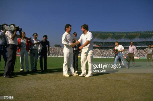 Allan Border of Australia shakes hands with Mike Gatting of England before the start of the World Cup final at Eden Gardens in Calcutta India...