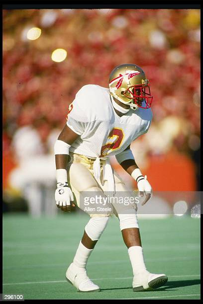 Cornerback Deion Sanders of the Florida State Seminoles stands in position during a game against the Florida Gators at Florida Field in Gainesville...