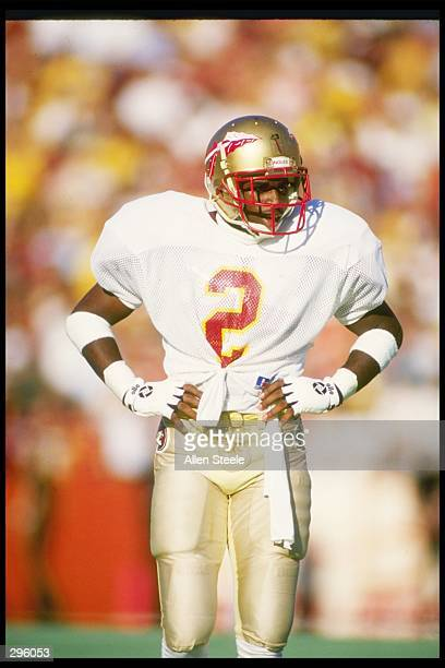 Cornerback Deion Sanders of the Florida State Seminoles stands on the field during a game against the Florida Gators at Florida Field in Gainesville...