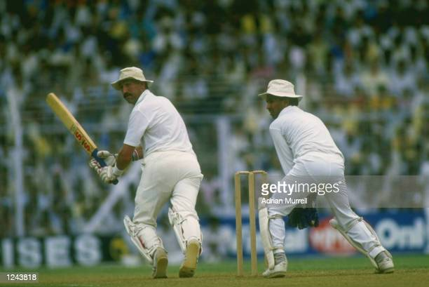 Graham Gooch of England guides the ball past India wicketkeeper Kieran More during the Cricket World Cup semifinal at Bombay which England won