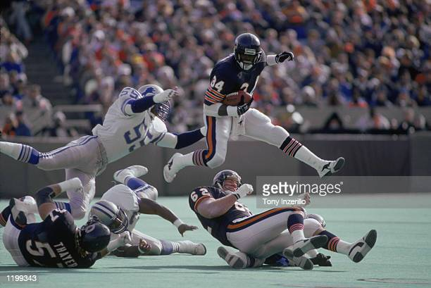 Running back Walter Payton of the Chicago Bears vaults over a defender duriung the NFL game against the Detroit Lions at Soldier Field in Chicago...