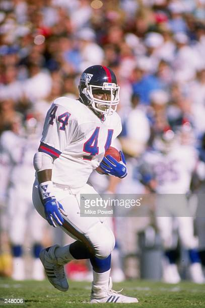 Fullback Maurice Carthon of the New York Giants runs with the ball during a game against the Phoenix Cardinals at Sun Devil Stadium in Tempe Arizona...