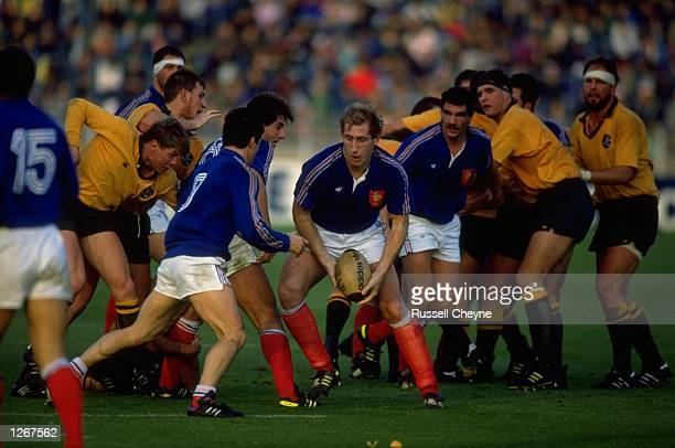Alain Carminati of France feeds the ball out during the match against Australia in Lille France France won the match 2519 Mandatory Credit Russell...