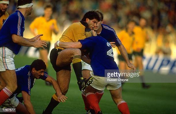 Brendan Masser of Australia is blocked by a French defender during the match against France in Lille France France won the match 2519 Mandatory...