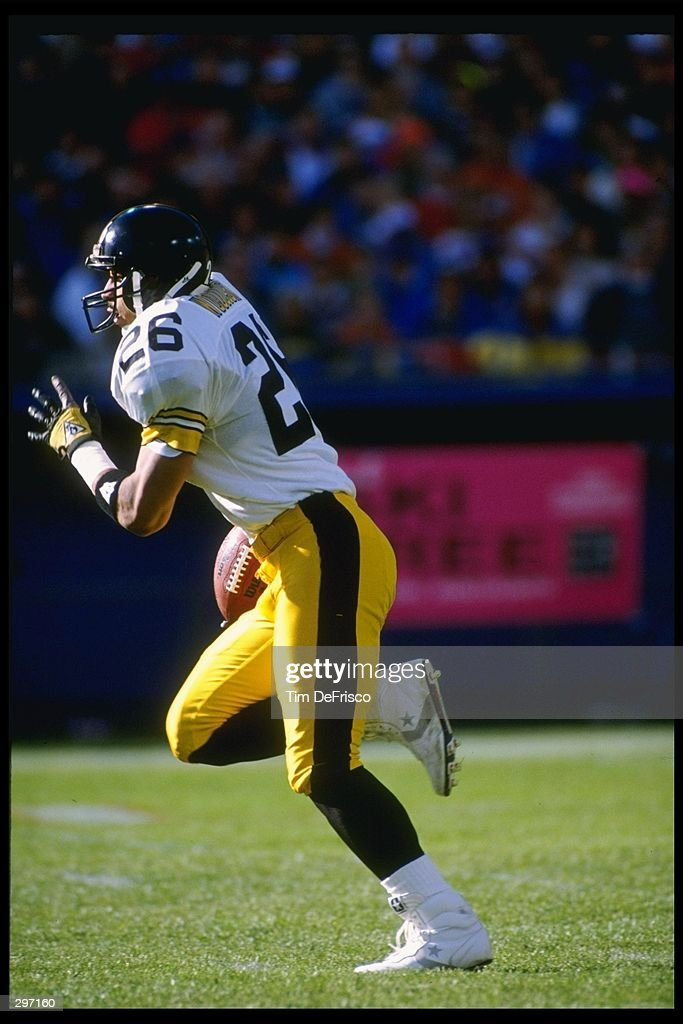 Defensive back Rod Woodson of the Pittsburgh Steelers moves the ball during a game against the Denver Broncos at Mile High Stadium in Denver, Colorado. The Broncos won the game, 34-7. Mandatory Credit: Tim DeFrisco /Allsport